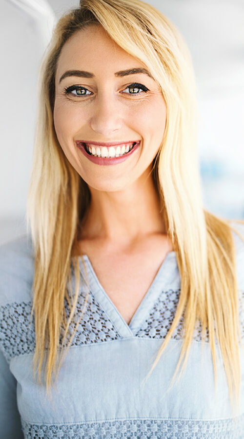 Blonde woman smiling with brand new smile